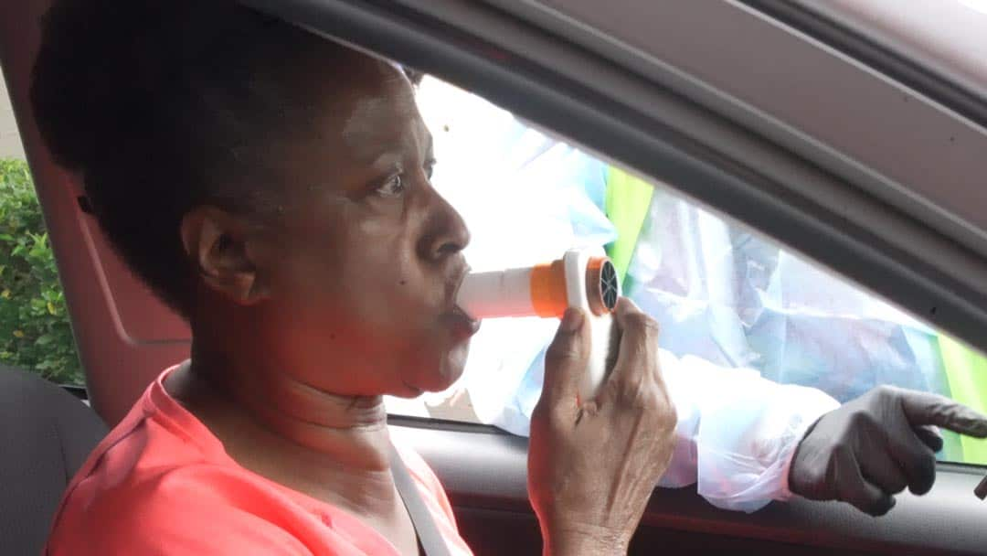 Woman getting a lung screening from her car in Atlanta.